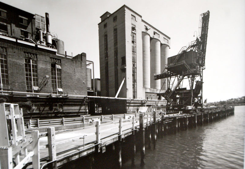 Refinery, coal silos and crane