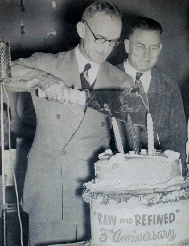 Cutting the cake (with a cane knife) to celebrate the third anniversary of the weekly concert ca 1950