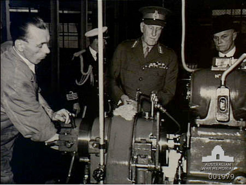 Governor General Lord Gowrie being shown how 18lb bomb shell cases are made 1940