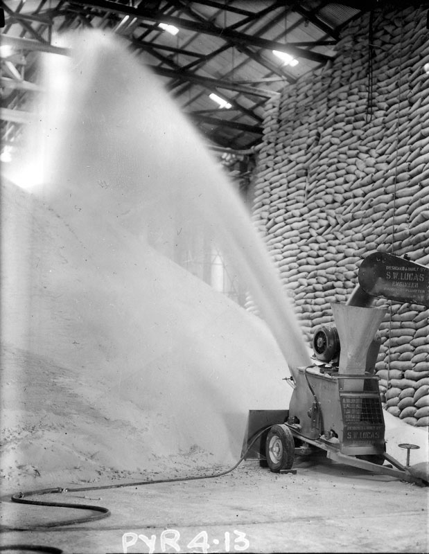 Raw sugar store, sugar thrower, circa 1960