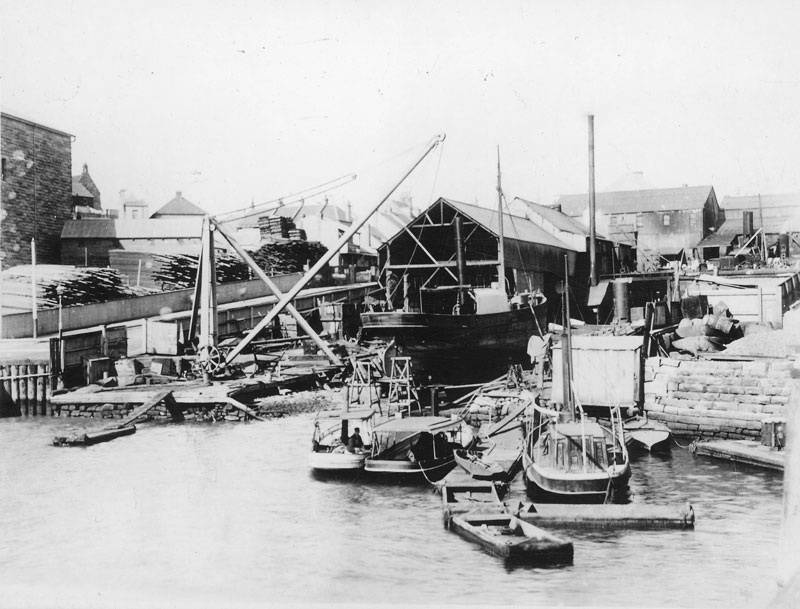 Small boats moored at CSR wharf, circa 1878